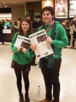 Tom and Ffion seeling the MUNity nemspaper.jpg