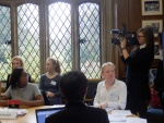 Meadow filming Security Council with Rolanda looking on.jpg